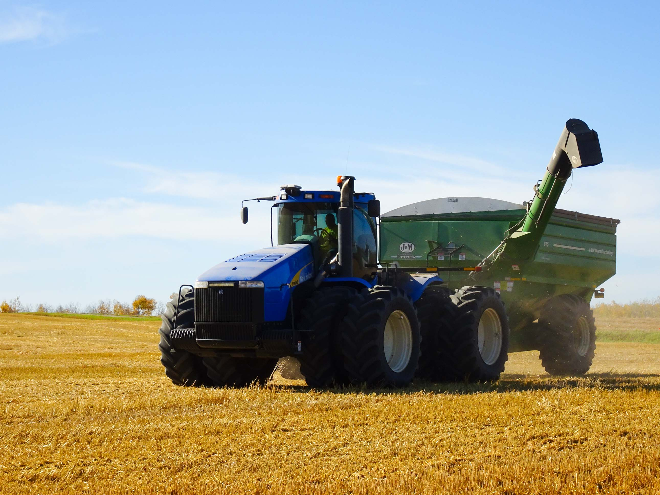 Grain Cart - collects grain from combines then empties into semi